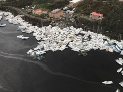 This photo provided by Caribbean Buzz shows boats clustered together after Hurricane Irma Friday, Sept. 8, 2017. The death toll from Hurricane Irma has risen to 22 as the storm continues its destructive path through the Caribbean. The dead include 11 on St. Martin and St. Barts, four in the U.S. Virgin Islands and four in the British Virgin Islands. There was also one each in Barbuda, Anguilla, and Barbados. The toll is expected to rise as rescuers reach some of the hardest-hit areas. (Caribbean Buzz via AP)