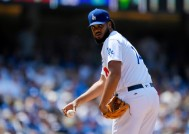 Los Angeles Dodgers relief pitcher Kenley Jansen checks first before throwing to the plate during the ninth inning of a baseball game against the Washington Nationals, Wednesday, June 7, 2017, in Los Angeles. (AP Photo/Mark J. Terrill) ORG XMIT: LAD120
